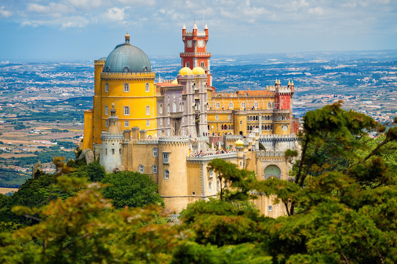 Panorama of Pena National Palace above Sintra town, Portugal. UNESCO World Heritage Site and one of the Seven Wonders of Portugal
